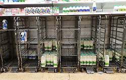 © Licensed to London News Pictures. 13/04/2021. London, UK. Nearly empty shelves of fresh milk in a Sainsbury's supermarket in Haringey, north London, just after 8am in the morning. Photo credit: Dinendra Haria/LNP