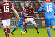 Kai Kennedy (#19) of Inverness Caledonian Thistle FC holds off Michael Smith (#2) of Heart of Midlothian FC during the SPFL Championship match between Heart of Midlothian and Inverness CT at Tynecastle Park, Edinburgh, Scotland on 7 November 2020.