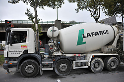 © Licensed to London News Pictures. 05/10/2017 Paris, FRANCE. Lafarge cement plant  Porte de Pantin, Paris, where petrol cans were found attached to a 'crude detonator' underneath several lorries belonging Franco-Swiss cement company Lafarg. Bomb disposal units were deployed and the area sealed off by police. The construction firm is already under investigation over claims that it indirectly funded ISIS in Syria in order to keep a plant running a war zone. Larfarg has also been criticised by President Emmanual Macron for alleged business deals with Trump's administration in the building of a anti-immigrant wall on the US-Mexico border. Photo credit: Guilhem Baker/LNP