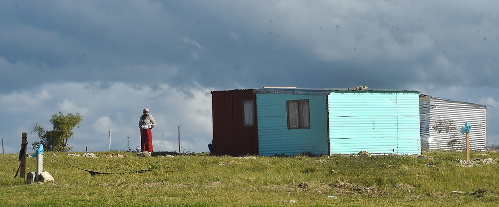 South Africa -Cape Town - 31 August 2020 - One of the land invaders along Mew Way road in Khayelitsha standas infront of her house ast dark clouds gather in Cape Town.The cold and wet weather is expected to continue for the rest of the week in Cape Town  .Picture:Phando Jikelo/African News Agency(ANA)