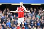 Shkodran Mustafi of Arsenal shrugs his shoulders after Marco Alonso of Chelsea scores. Premier league match, Chelsea v Arsenal at Stamford Bridge in London on Saturday 4th February 2017.<br /> pic by John Patrick Fletcher, Andrew Orchard sports photography.