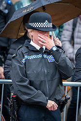 © Licensed to London News Pictures. 14/10/2019. Oxford, UK. A police officer wipes away tears as the funeral procession makes its way through Oxford city centre for the funeral of Thames Valley Police officer PC Andrew Harper. Photo credit: Peter Manning/LNP