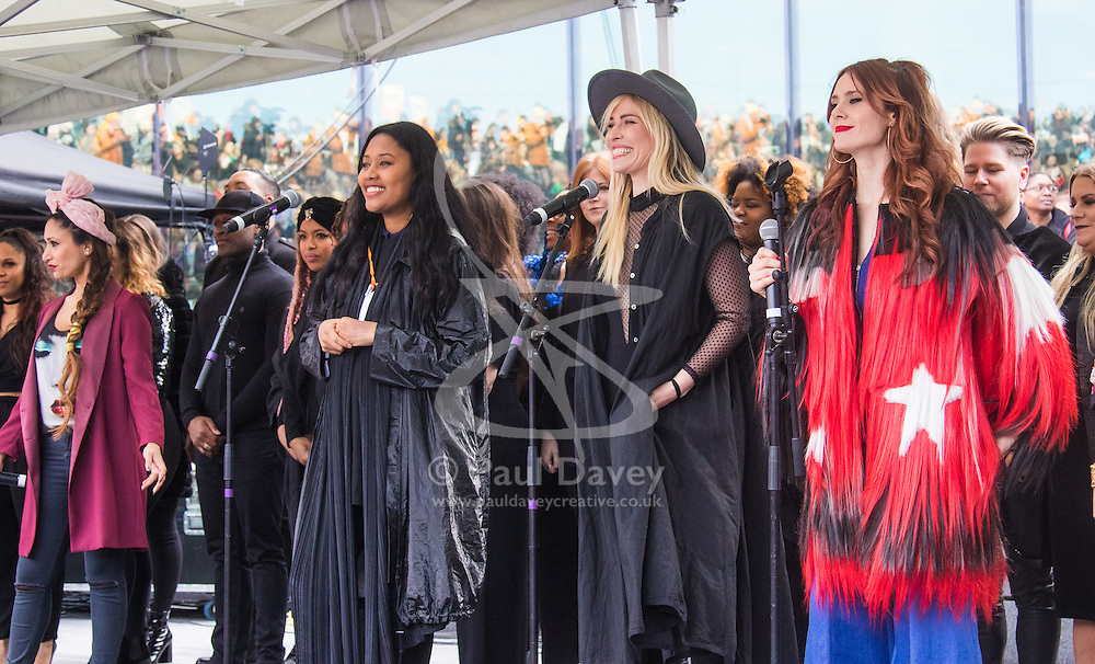 """City Hall, London, March 5th 2017. Stars join March4Women through London. Mayor of London Sadiq Khan and suffragette descendents prepare to march and """"sing for a fairer world ahead of International Women's Day"""". Attended by Annie Lennox, Emeli Sande, Helen Pankhurst, Bianca Jagger and with musical performances from Emeli Sande, Melanie C and more. PICTURED: (L-R) Preeya Kalidas, VV Brown, Natasha Beddingfield and Kate Nash perform 'Respect' for the crown with Mel C (not pictured)"""