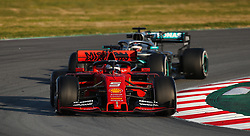 File photo dated 18-02-2019 of Ferrari's Sebastian Vettel leads Mercedes Lewis Hamilton during day one of pre-season testing at the Circuit de Barcelona-Catalunya.