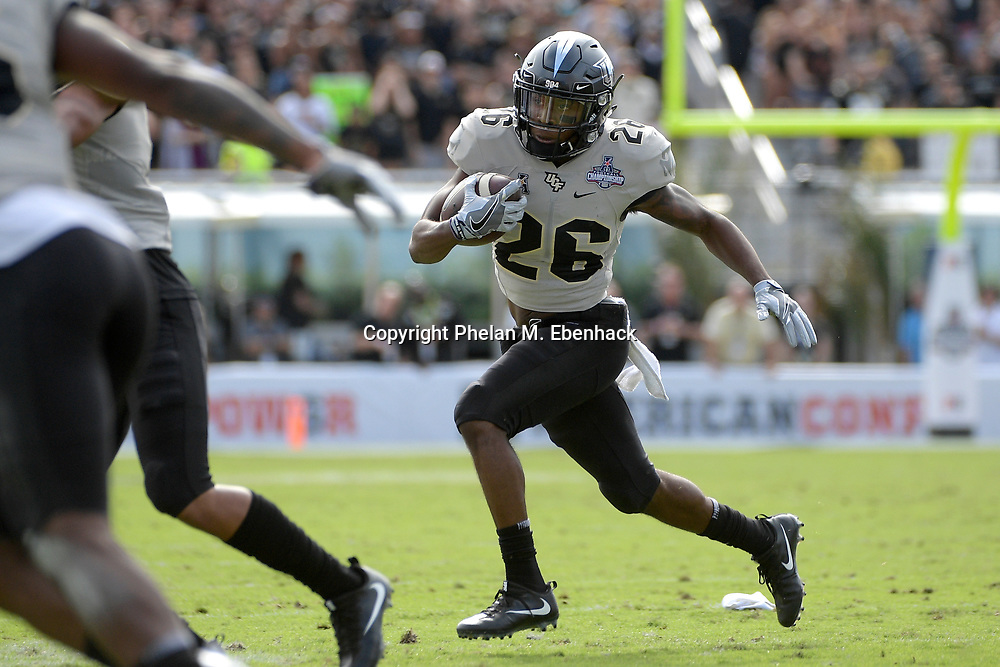 Central Florida wide receiver Otis Anderson (26) runs after a catch during the first half of the American Athletic Conference championship NCAA college football game against Memphis Saturday, Dec. 2, 2017, in Orlando, Fla. (Photo by Phelan M. Ebenhack)