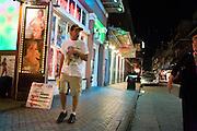 19 SEPTEMBER 2006 - NEW ORLEANS, LOUISIANA: Men walk by strip clubs on Bourbon Street in New Orleans. Photo by Jack Kurtz / ZUMA Press