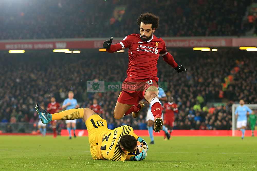 14 January 2018 - Premier League Football - Liverpool v Manchester City - Mohamed Salah of Liverpool leaps over Man City goalkeeper Ederson Moraes as he makes a save - Photo: Simon Stacpoole / Offside