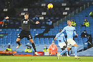 Burnley defender Matthew Lowton (2) heads the ball away during the Premier League match between Manchester City and Burnley at the Etihad Stadium, Manchester, England on 28 November 2020.