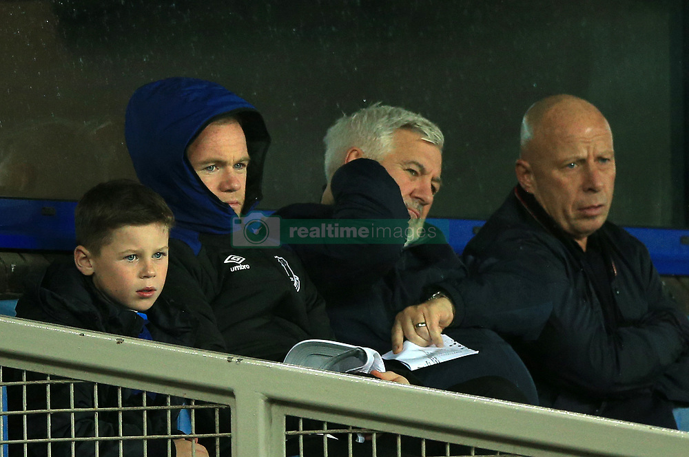 Everton's Wayne Rooney sits alongside his agent Paul Stretford in the stands during the UEFA Europa League, Group E match at Goodison Park, Liverpool.