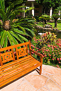 Bench and garden at the Kauai Marriott Resort, Island of Kauai, Hawaii