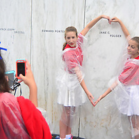 """Members of the North Stars Kids Performance Troupe from Pittsburgh. form a heart for a cellphone photo along the """"Wall of Names"""" at the Flight 93 National Memorial on the 13th Anniversary of the 911 terrorist attacks on September 11, 2014.  UPI/Archie Carpenter"""