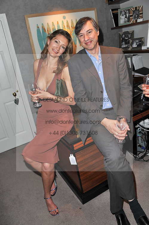 ANASTASIA ALEXANDER and ALBERT MUNKENBECK at a party to celebrate the publication of 'Garden' by Randle Siddeley held at Linley, 60 Pimlico Road, London on 24th May 2011.