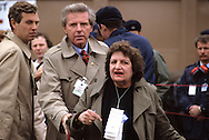 Helen Thomas trying to ask a question in German? with SS agent Bob Snow behind her.  It could be President Reagan's trip to the Bonn summit...Photograph by Dennis Brack