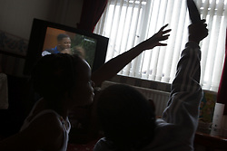 Brother and sister fighting over the TV remote control,