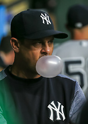 April 30, 2018 - Houston, TX, U.S. - HOUSTON, TX - APRIL 30:  New York Yankees manager Aaron Boone (17) enjoys bubblegum in the visitors' dugout during the baseball game between the New York Yankees and Houston Astros on April 30, 2018 at Minute Maid Park in Houston, Texas.  (Photo by Leslie Plaza Johnson/Icon Sportswire) (Credit Image: © Leslie Plaza Johnson/Icon SMI via ZUMA Press)