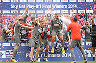 Rotheram United players celebrate lifting the League One Playoff Trophy. Skybet football league one play off final match , Leyton Orient  v Rotherham Utd at Wembley Stadium in  London on Sunday 25th May 2014.<br /> pic by John Patrick Fletcher, Andrew Orchard sports photography.