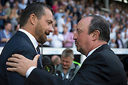 Rafa Benitez, the Newcastle United manager (r) talks to Slavisa Jokanovic, the Fulham manager before k/o. Skybet EFL championship match, Fulham v Newcastle Utd at Craven Cottage in Fulham, London on Friday 5th August 2016.<br /> pic by John Patrick Fletcher, Andrew Orchard sports photography.