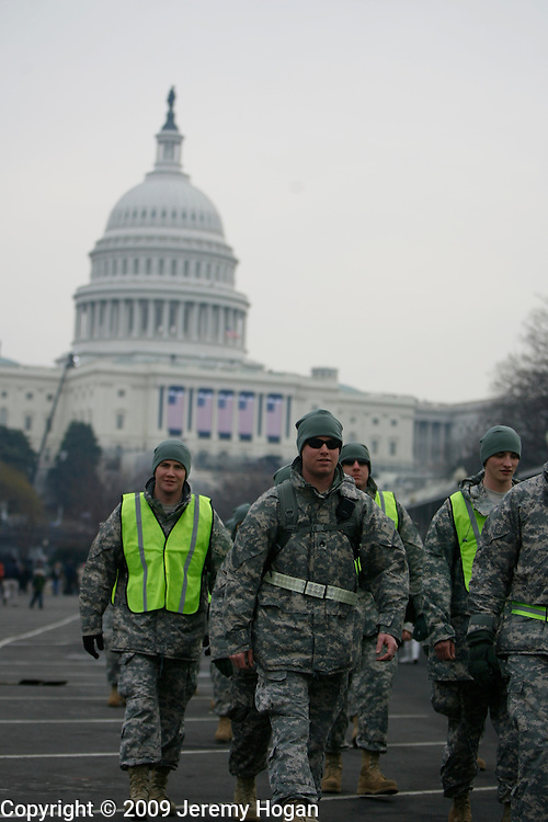 Soldiers patrol near the United States Capital building where Barack Obama will be sworn in as president Tuesday.