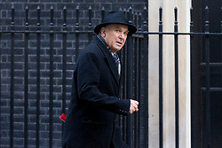© Licensed to London News Pictures. 26/11/2013. London, UK. The Business Secretary, Vince Cable, leaves Number 10 Downing Street after a meeting of British Prime Minister David Cameron's Cabinet on Downing Street in London today (26/11/2013). Photo credit: Matt Cetti-Roberts/LNP