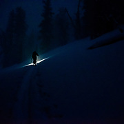 Forrest Jillson skiing at night during a winter storm in the Tetons of Wyoming.
