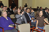 Nassau County Legislature, controlled by Republicans, votes along party lines to consolidate 8 police precincts into 4, on Monday, March 5, 2012, at Mineola, New York, USA. Milagros Vicente (center, pointing finger), a North Valley Stream resident, shouted out in audience after a Yes vote by one of the legislators.
