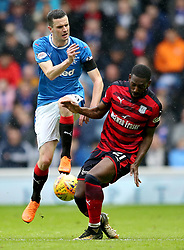 Rangers' Jamie Murphy (left) and Dundee's Roarie Deacon battle for ball during the Ladbrokes Scottish Premiership match at the Ibrox Stadium, Glasgow.