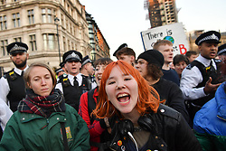 © Licensed to London News Pictures 15/02/2019 Westminster, London, UK. Chenya (16) (centre) with friends at the end of the student climate protest infont of parliament. According to legal observers 3 arrests were made during the course of a day of protest against inaction over climate change, where thousands of  schoolchildren staged demonstrations across the country Photo credit: Guilhem Baker/LNP