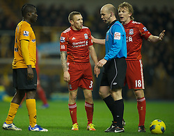 31.01.2012, Molineux Stadion, Wolverhampton, ENG, PL, Wolverhampton Wanderers vs FC Liverpool, 23. Spieltag, im Bild Liverpool's Craig Bellamy and Dirk Kuyt appeal to the referee Anthony Taylor after a penalty appeal was turned down against Wolverhampton Wanderers during the football match of English premier league, 23rd round, between Wolverhampton Wanderers and FC Liverpool at Molineux Stadium, Wolverhampton, United Kingdom on 2012/01/31. EXPA Pictures © 2012, PhotoCredit: EXPA/ Propagandaphoto/ David Rawcliff..***** ATTENTION - OUT OF ENG, GBR, UK *****