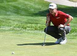 July 13, 2018 - Silvis, Illinois, U.S. - SILVIS, IL - JULY 13:  Mackenzie Hughes sets up his putt on the #1 green during the second round of the John Deere Classic on July 13, 2018, at TPC Deere Run, Silvis, IL.  (Photo by Keith Gillett/Icon Sportswire) (Credit Image: © Keith Gillett/Icon SMI via ZUMA Press)