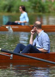 The Duke and Duchess of Cambridge cox a boat each in a competitive race between the twinned town of Cambridge and Heidelberg, Germany.