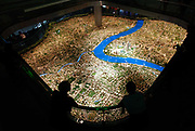 Visitors look at a scaled model of the Shanghai city center at the Urban Planning Museum in Shanghai, China on 25 October 2010.  Shanghai, China's largest city, is quickly becoming one of the major financial centers of the world.
