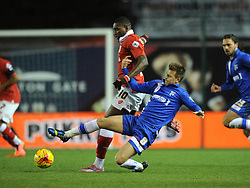 Bristol City's Jay Emmanuel-Thomas is tackled by Gillingham's Jake Hessenthaler - Photo mandatory by-line: Dougie Allward/JMP - Mobile: 07966 386802 - 29/01/2015 - SPORT - Football - Bristol - Ashton Gate - Bristol City v Gillingham - Johnstone Paint Trophy