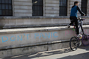 A cyclist evironmental activist protests about Climate Change during an occupation of Trafalgar Square in central London, the third day of a two-week prolonged worldwide protest by members of Extinction Rebellion, on 9th October 2019, in London, England.