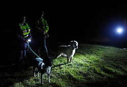 © Licensed to London News Pictures. 07/09/2013.  Raleighs Cross, Somerset, UK.  A couple with their dogs kept on leads join the Somerset badger patrol, where campaigners against the cull looking for dead or wounded badgers on public footpaths and roads.  The Government has licensed a pilot badger cull in parts of Somerset and Gloucestershire as part of efforts to reduce bovine tuberculosis in cows on farms.  07 September 2013.<br /> Photo credit : Simon Chapman/LNP
