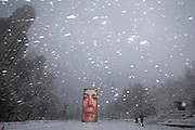 Two men walk past the Crown Fountain in blizzard conditions in Chicago, Illinois, February 1, 2015.  REUTERS/Jim Young