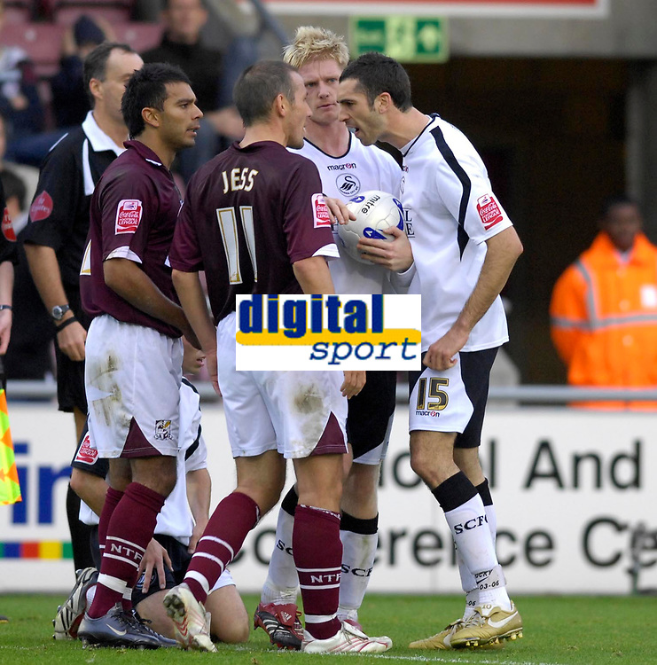 Photo: Daniel Hambury.<br />Northampton Town v Swansea City. Coca Cola League 1. 28/10/2006.<br />Northampton's Eoin Jess (L) and Swansea's Tom Willimas square up to one another.