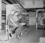 Two male workers in control room of factory, Kemi, Lappi, Finland 1963