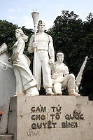 """Vietnamese Revolutionary Statue in Hanoi.  Though still officially a """"communist nation"""" you'd never know it to step into the streets of Hanoi or Saigon where commerce seems to be a 24 hour event.  Only by dealing with government officials or the sight of revolutionary statues around town remind you that, yes, Vietnam is still communist."""