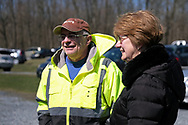 Becky's Drive-In operators Dean Deppe, left, and his wife Cindy Deppe, right, talk about the experience of hosting Bethany Wesleyan Church's Sunday worship service Mar. 22, 2020, at the venue in Walnutport, Pennsylvania. Concerns over the coronavirus have closed churches in an effort to avoid gatherings of large crowds.
