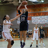 On Tuesday night, Siigrid Lii'bilnaghahi (20) of Kirtland Central spots up for a jump shot against Ashley Antone (1) of Gallup for the score in Gallup. Kirtland Central won 62-53.