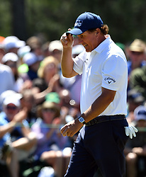 Phil Mickelson putts for birdie on the 2nd hole during the third round of the Masters Tournament at Augusta National Golf Club in Augusta, Ga., on Saturday, April 8, 2017. (Photo by Brant Sanderlin/Atlanta Journal-Constitution/TNS) *** Please Use Credit from Credit Field ***