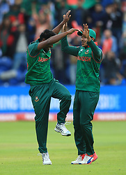 Bangladesh's Rubel Hossain (left) celebrates after taking the wicket of New Zealand's Martin Guptill during the ICC Champions Trophy, Group A match at Sophia Gardens, Cardiff.