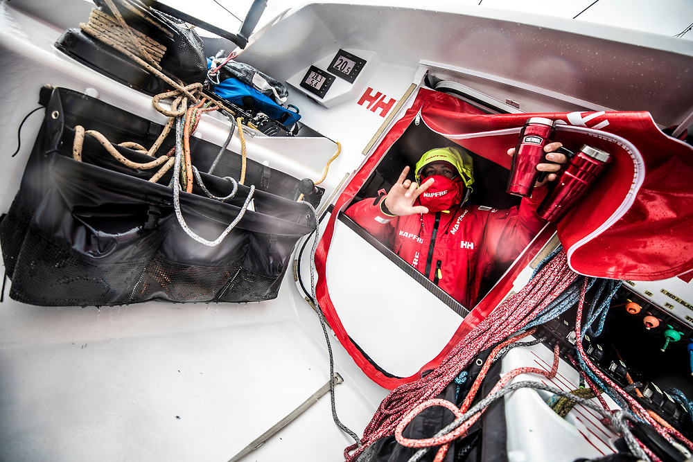 Leg 02, Lisbon to Cape Town, day 17, on board MAPFRE, ''Coffee is here!'' Antonio Cuervas-Mons going out from the hatch for his watch carring a lot of coffee for everyone. Photo by Ugo Fonolla/Volvo Ocean Race. 21 November, 2017