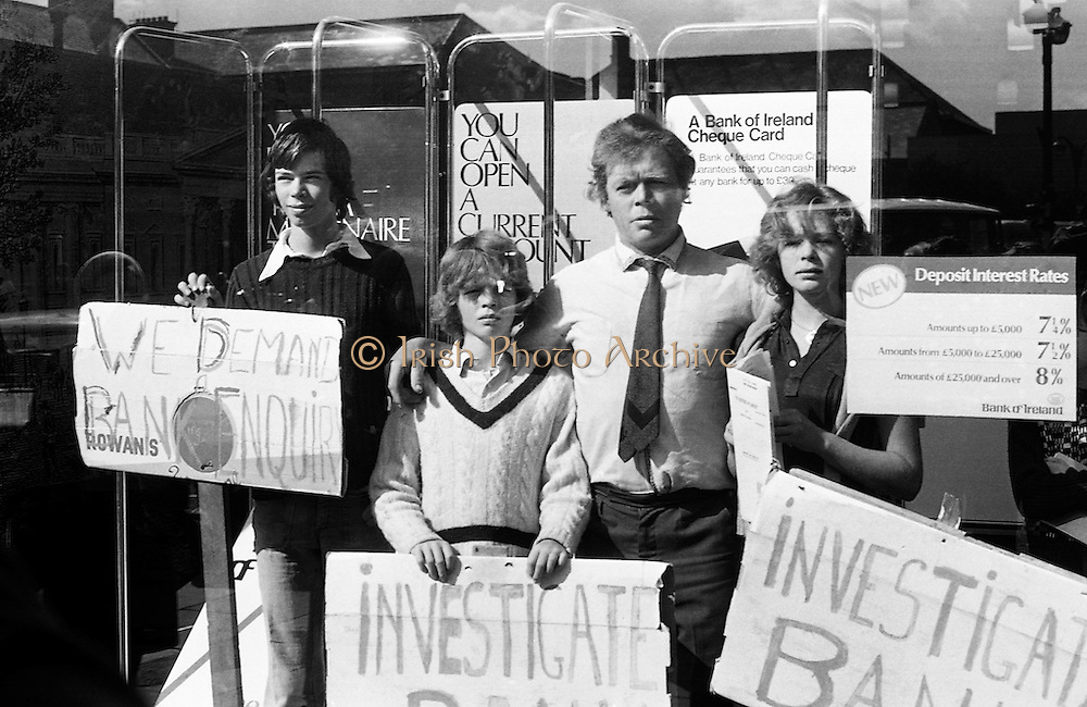 Fergus Rowan, a Dublin seed merchant, and members of his family stage a sit in at Bank of Ireland HQ in Westmoreland Street, Dublin. Following the 1970 bank strike the family business found itself in financial difficulties, having accepted cheques in good faith, which were declined by the bank, as 'dodgy'. The business was eventually put into receivership. <br /> 22/08/1975
