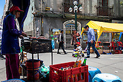 A woman sells food on the street, while a couple takes their son for a ride on the historical Murillo Square usually filled with cars and traffic, La Paz. During elections period in  Bolivia, the country faces several restrictions, like no alcohol for sale 48 hours before and 12 after the election; no public gatherings, shows of any kind until the political parties made their speeches on the election night; its completely forbidden the circulation of any vehicles, private or governmental except with the permit from the Electoral Tribunal, which means it would be basically no cars, buses or anything circulating in the city; no long distance buses, the terminal will be close from Saturday until Monday and even flights will not be allowed except the ones leaving the country or the international ones doing stop-over. It is a completely shut down of the country.