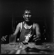 Portrait of a serious and sad Laos in market cook of Vientiane, Laos, Asia