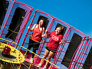 "26 JUNE 2019 - CENTRAL CITY, IOWA: Girls on the ""Black Hole"" one of the rides at the Linn County Fair. Summer is county fair season in Iowa. Most of Iowa's 99 counties host their county fairs before the Iowa State Fair, August 8-18 this year. The Linn County Fair runs June 26 - 30. The first county fair in Linn County was in 1855. The fair provides opportunities for 4-H members, FFA members and the youth of Linn County to showcase their accomplishments and talents and provide activities, entertainment and learning opportunities to the diverse citizens of Linn County and guests.    PHOTO BY JACK KURTZ"
