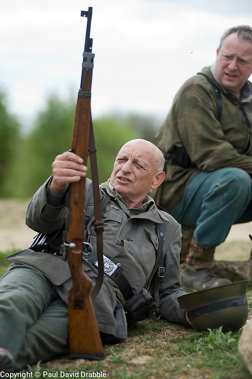 Reenactors from Northern World War Two Association, dressed as members of the elite Gross Deutschland division take a break,during a private 24hr excerise, held at Sutton Grange, near Ripon in Yorkshire 15  May 2010 .Images © Paul David Drabble.