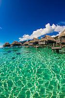 Overwater bungalows in the lagoon (inside the reef), Hilton Moorea Lagoon Resort, island of Moorea, French Polynesia.