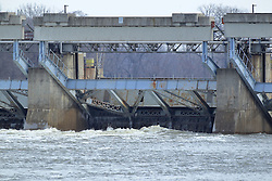 11 February 2017:  Ice hangs from some parts of the Lasalle Lock on Illinois River at Starved Rock State Park in Illinois as the water churns below